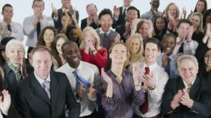 stock-footage-a-large-multi-ethnic-group-of-business-people-stand-together-isolated-on-white-in-a-studio-shot